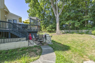 UNDER CONTRACT - $689,900 - Incredible basement for entertaining, backing to trees in South Riding!