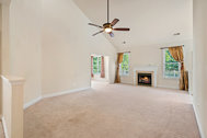 SOLD - Brick front home with main level master suite backing to trees in gated, golf course 55+ community of Heritage Hunt!