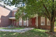 UNDER CONTRACT SUBJECT TO LENDER AND BANKRUPTCY COURT APPROVAL - $859,900 - Huge brick front home with 7 bedrooms 6.55 bathrooms and expansive deck and stone patio backing to trees!