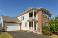 FOR SALE - $549,900 - Brick front home on a corner lot in a suburban community in Loudoun County wine country!