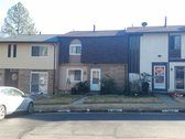 FOR SALE - $179,900 - Three level townhome in popular Lake Ridge on a quiet street backing to woods!