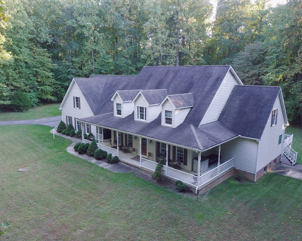CUSTOM BUILT 8 BEDROOM, 5 ½ BATH HOME ON A 3.65+/- ACRE PRIVATE WOODED LOT