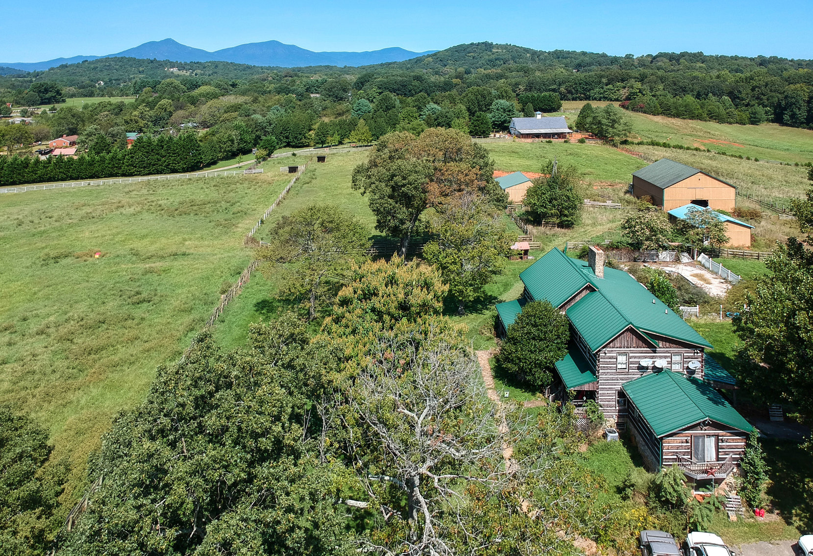 33 Acre Farm with Log Home & 3 Barns