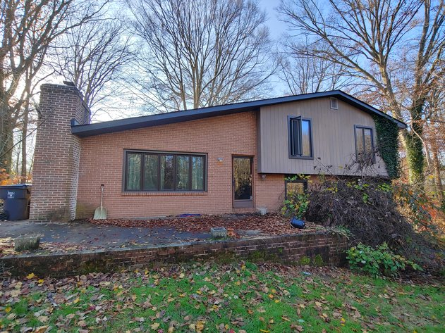 BRICK AND WOOD SIDED TRI-LEVEL HOME 3 BR, 2½ BA ON 1.16 +/- ACRES IN 2 PARCELS
