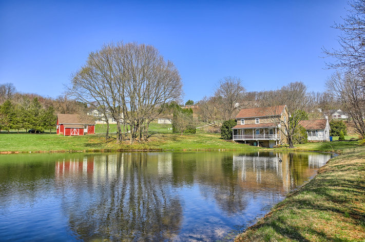3 BR, 2.5 BA HISTORIC STONE HOME W/ DETACHED 2 CAR GARAGE & SUMMER HOME OVERLOOKING POND ON 14.04+/- AC
