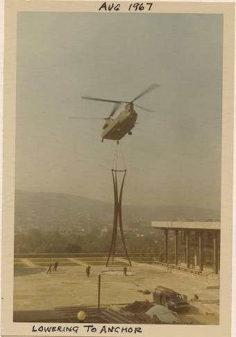 The Symbol of Progress being air lifted in