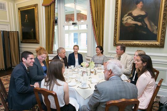 Ambassadors Timothy Chorba, Philip Hughes and Thomas Siebert talk with Fellows and peer mentors