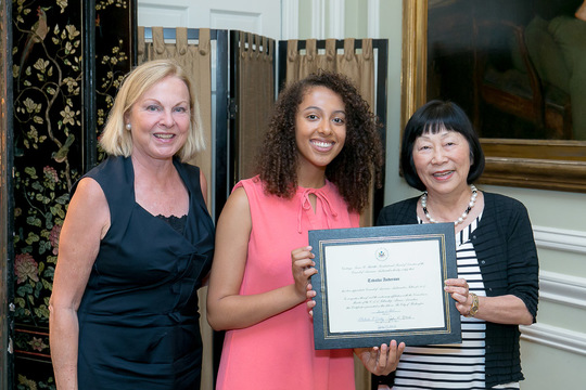 Tabatha Anderson Receives Her Certificate from Ambassadors Laurie Fulton and Julia Chang Bloch