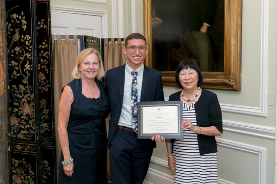 Luis Calvo receives his Certificate from Ambassadors Julia Chang Bloch and Laurie Fulton