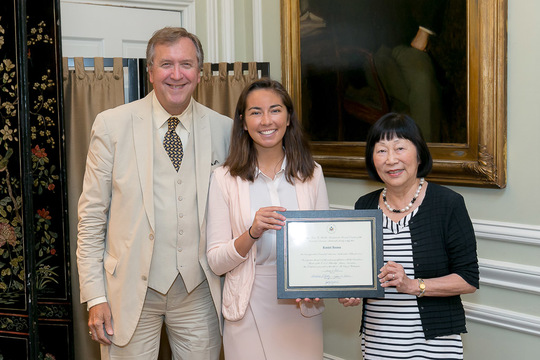 Ambassadors Julia Chang Bloch and G. Philip Hughes present Rachel Iacono with her Certificate