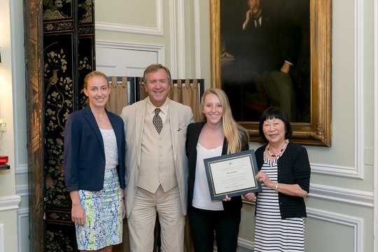 Brittney Kidwell receives her Certificate from Ambassadors Bloch and Hughes and peer mentor Caryl Merten