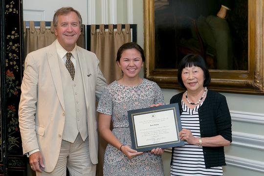 Jamie Kwong receives her Certificate from Ambassadors Bloch and Hughes