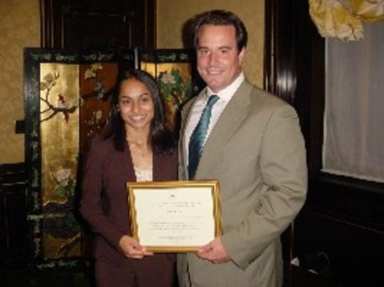 Class of 2006 Fellow Aisha Sabar and Ambassador Stuart W. Holliday
