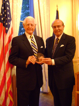 Ambassador Glen A. Holden receives the Henry L. Kimelman ~ Milton A. Wolf Award on May 6, 2013