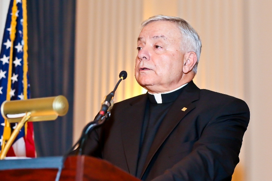 30th Anniversary Gala: Father William L. George, S.J. Offers the Invocation. Photo credit Tony Powell