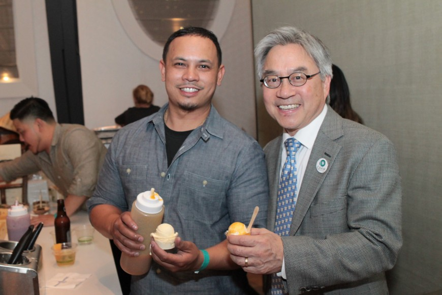 CAAM Executive Director Stephen Gong (right) tries Frozen Kuhsterd