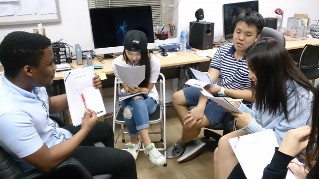 Students from the documentary My Voice, My Life are tutored by a University of Hong Kong volunteer.