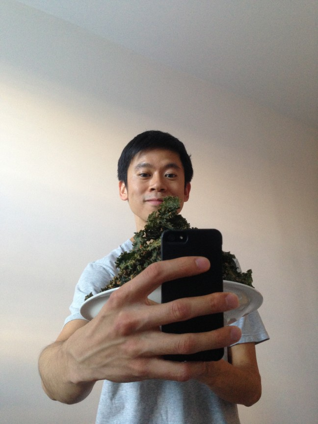 Sheng Wang selfie with a plate of kale chips. Photo by Ruth Sarreal.