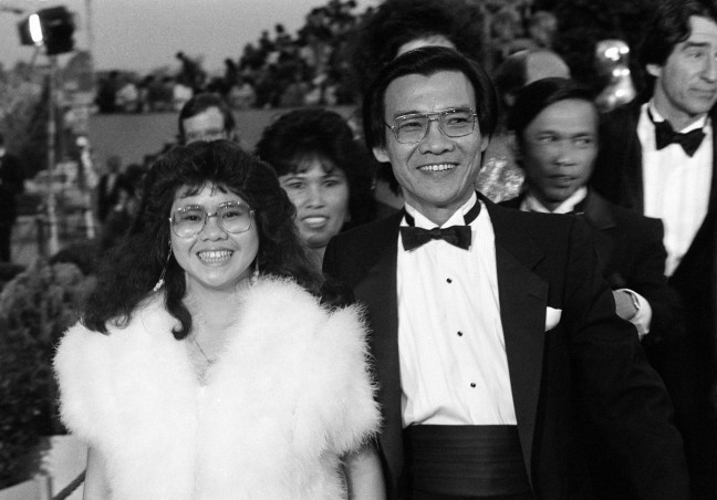 "Dr. Haing S. Ngor, right, accompanied by his niece Sophia Ngor, arrives at the 57th Annual Academy Awards® in Los Angeles, Calif., March 25, 1985. Ngor won the Best Supporting Actor Oscar® for his portrayal of a Cambodian refugee in the film ""The Killing Fields."" (AP Photo by Mark Elias)"