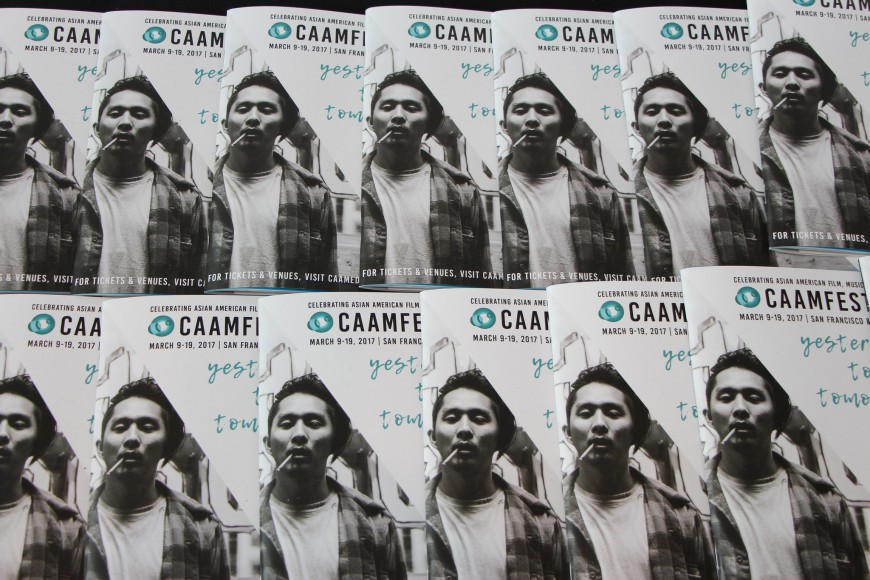 "CAAMFest 2017 program guides with Justin Chon in ""Gook"" on the cover. Photo by Carmine Bai for CAAM."