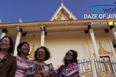An image of four Cambodian American women in front of a building in Cambodian. They look determined. They are here at the UN Khmer Rouge Tribunals hoping to find peace and justice.