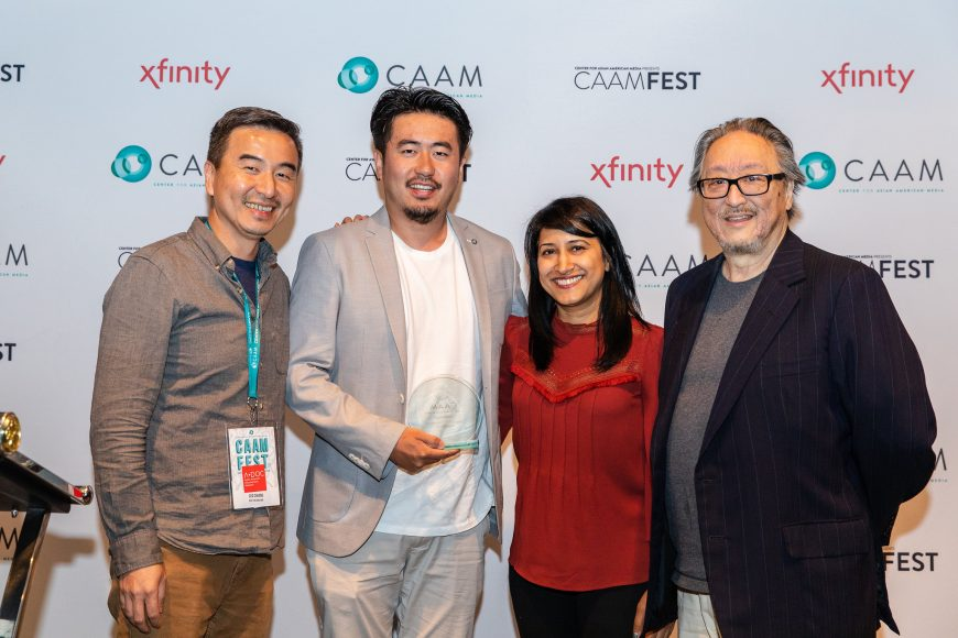 "Leo Chiang (left) accepts award for Best Documentary for ""Our Time Machine"" (tied with Jason DaSilva's ""When We Walk"") at the CAAM Filmmaker Awards Brunch. Photo by Kelsey Ogden."