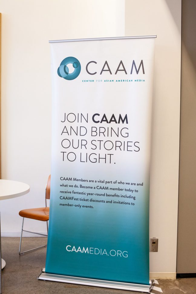 "A banner says ""Join CAAM and bring our stories to light."""