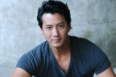 A Chinese American man poses for a headshot.