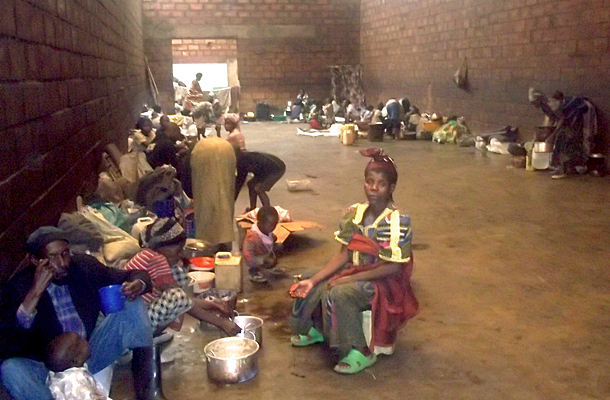 Families at Nkamira Transit Camp, Rwanda, seek shelter