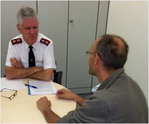 Major Henk van Hattem debriefs