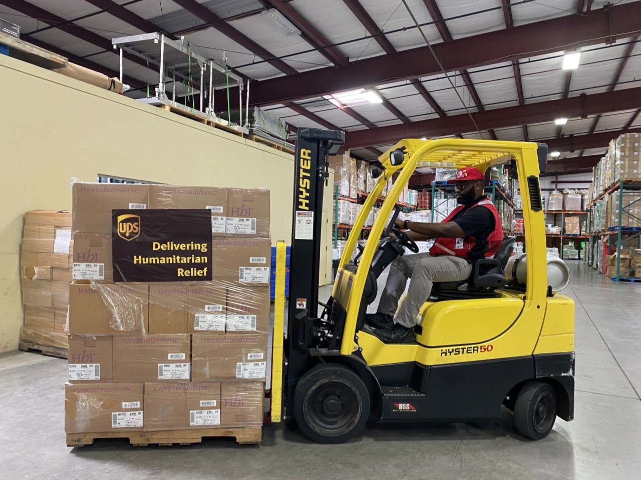 Fork-lift truck loading Salvation Army emergency supplies