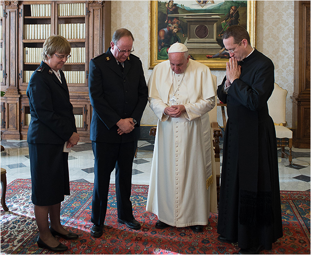 The General, Commissioner Silvia Cox and His Holiness Pope Francis pray together in the Vatican