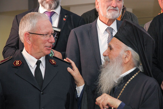 The General and the Archbishop greet each other