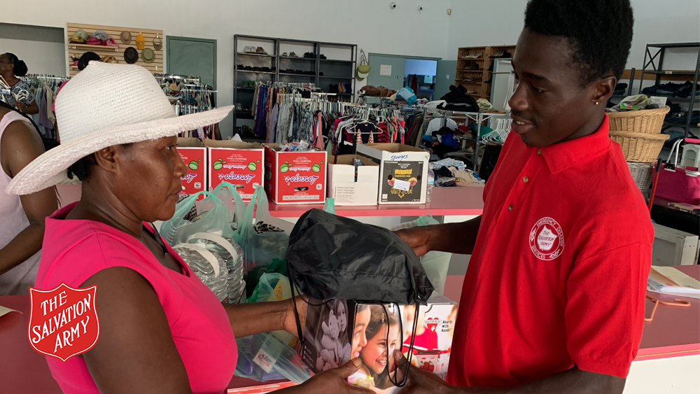 Akeem Cooper helping at the Freeport Salvation Army centre