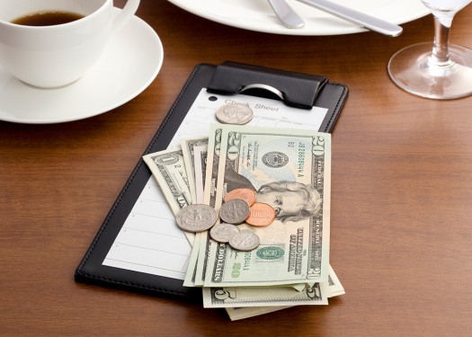 Check on restaurant table to talk about tipping policy