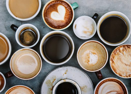 various coffee styles laid on tabletop including top coffee trends