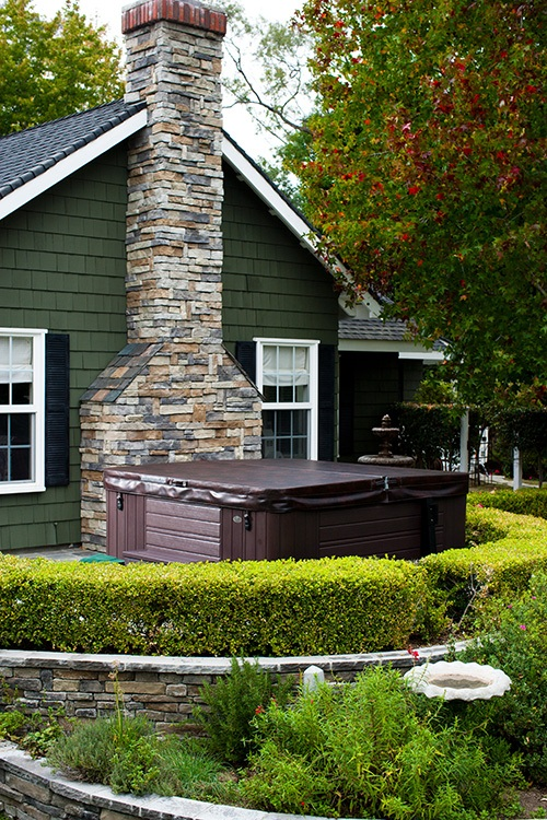 a garden hot tub can be a great addition to a formal garden with clearly defined edges and shapes