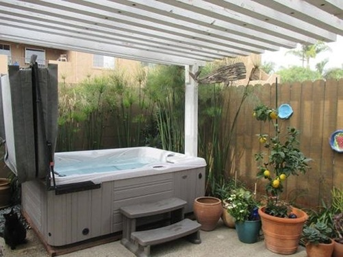 a hot tub on a crowded but scenic patio is more of a challenge to maintain