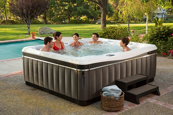 A large family enjoys the extra room and seats the come in a larger hot tub like the Utopia Cantabria