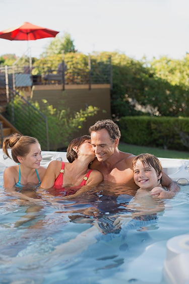 personal conversation is easier when a family uses a hot tub together