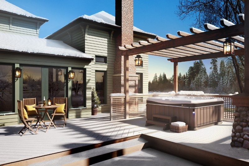 winter scene modern hot tub spa backyard bungalow style home