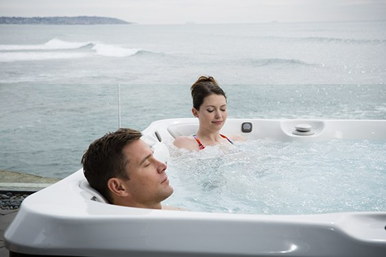 a couple enjoys a relaxing soak and good health in the best and most affordable hot tub price