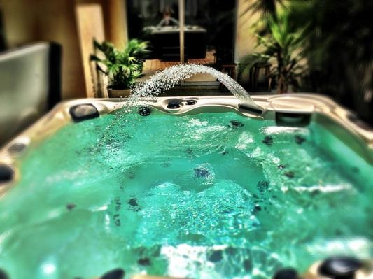 a customer submitted image of a caldera hot tub with the acquarella water fountain feature