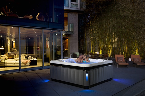 an image of a Caldera Utopia Tahitian best hot tub on a beautiful backyard patio with low maintenance and best price