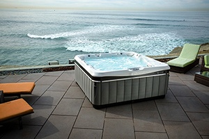 a modern energy efficient Utopia Spa Hot Tub on a seaside patio