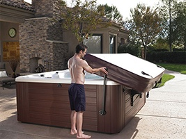 a man alone can easily open his hot tub cover with a lifter