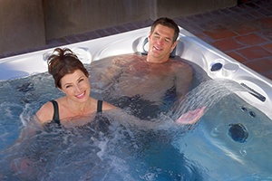 a couple enjoys a soak with the easiest spa water care maintenance