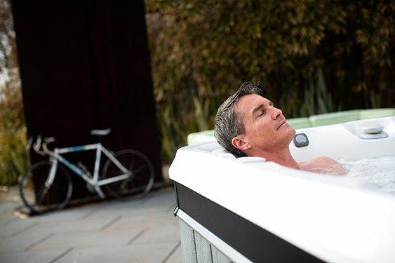 a man soaks in warm water hot tub therapy to fall asleep faster