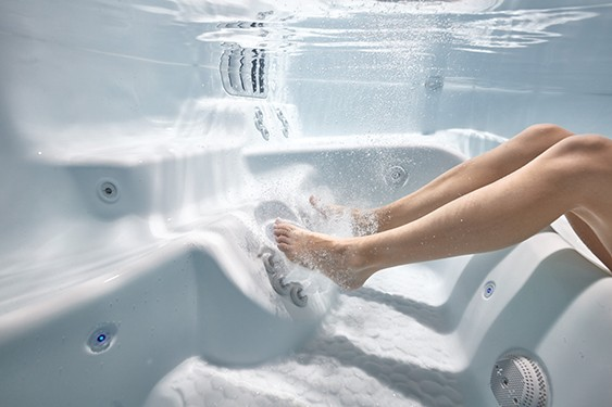 An image of a hot tubbers feet which are a perfect distance from the hot tub massage jets