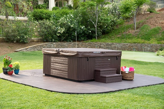 a hot tub spa becomes a center recreational focal point for any backyard design